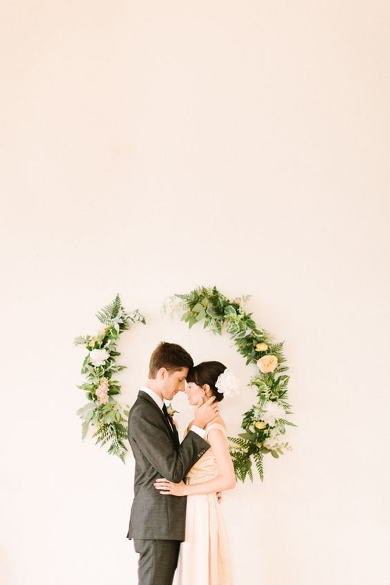 Floral wreath on the wall makes a pretty photo backdrop: