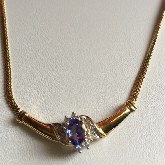 10k Italian Crafted Tanzanite & Diamond Necklace Rich in Color, Clarity is brilliant and this supreme Tanzanite is an 8x6 Oval..  Inlaid Diamonds along the edges with other Diamonds around the Gemstone. Incredibly Classy... Rich & Regal Design..    Made In Italy.10k Gold Tanzanian Dreams Jewelry Necklaces