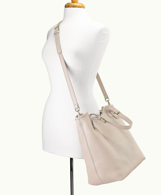 The elegant shape and style of the Taylor Tote features a full interior pocket and magnetic closure. This tote is suited for everyday use or travel.