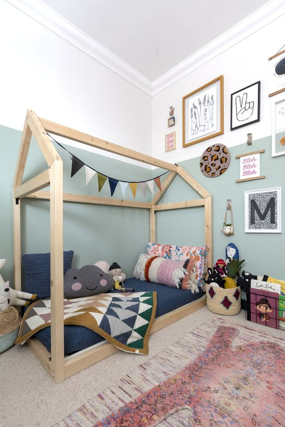 Cool two-tone walls, a gallery of prints and a house-shaped bed make this kids room the perfect place for child's play. #bedroom #kidsbedroom #realhomes