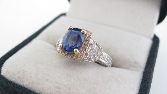 18 Karat, two- tone gold, sapphire and diamond ring.