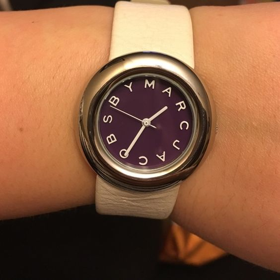 Marc by Marc Jacob Watch Beautiful Marc by Marc Jacobs purple face, silver, and white genuine leather watch. All silver is stainless steel. Watch face and silver are both in excellent condition with no scratches. Band has minor wear, but has lots of life left! Thank you for looking! Marc by Marc Jacobs Accessories Watches