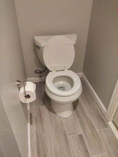 Dovewood Wood Ceramic Tile With Oyster Colored Sanded Grout The Toilet Raised Above New Floor