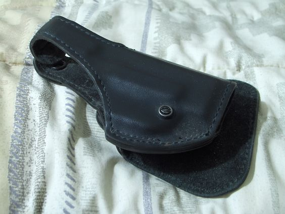 SAFARILAND Glock 518 183 Paddle Holster Black Leather Body Used  http://ajunkeeshoppe.blogspot.com/search/label/Sports%20-%20Gun%20Holsters