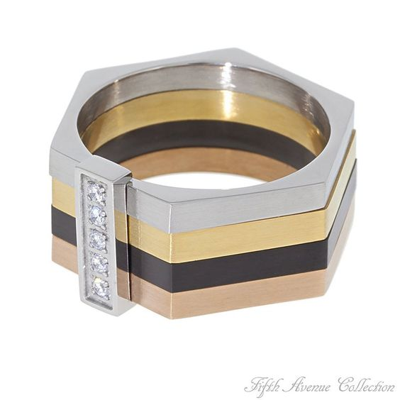 Strut Your Colors - Hexagon strips of stainless steel, black hematite and burnished bronze set the scene for five brilliant cubic zirconia.