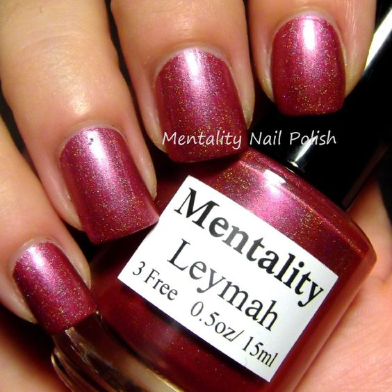 Mentality Nail Polish - Leymah, a soft red holographic nail polish. Dries to a semi gloss finish great for stamping.