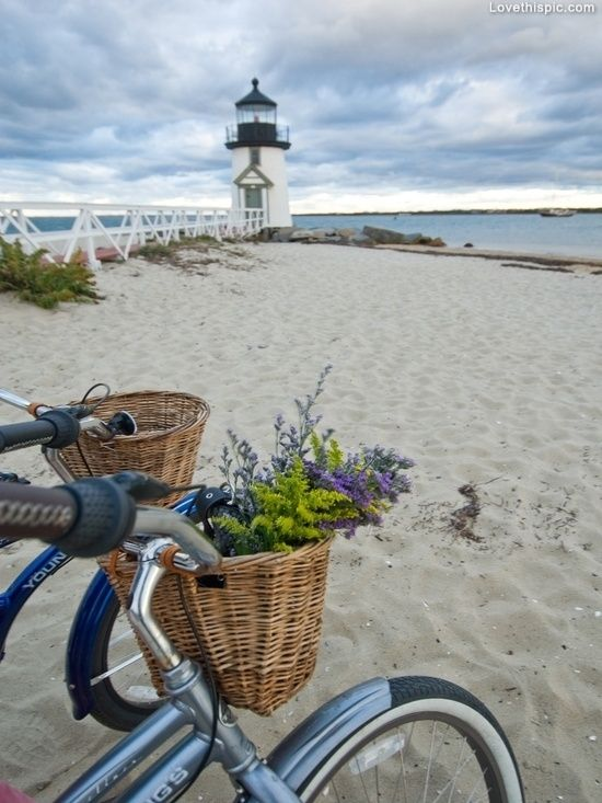 Parked by the lighthouse summer sky beach ocean clouds flowers bike