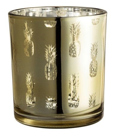 Gold/pineapple. Glass tea light holder with a shimmering metallic pattern. Height 3 1/4 in., diameter 2 3/4 in.