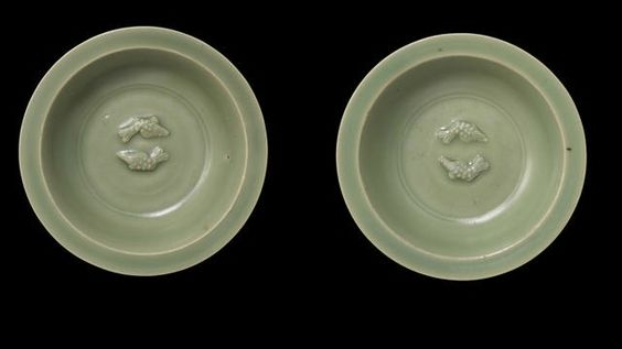 A pair of small Longquan celadon 'twin fish' dishes, Southern Song-Yuan Dynasty