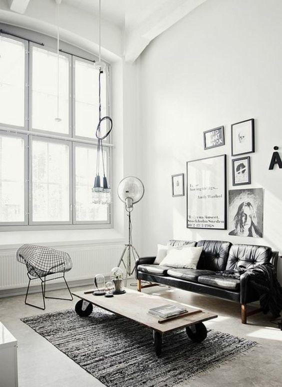 canapé vintage en cuir pour salon minimaliste en noir et blanc