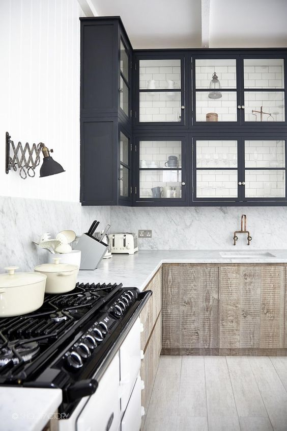 navy top cabinets + natural wood cabinets below + subway tile in glass front cabinet | via Modern & Classic Kitchens ~ Cityhaüs Design:
