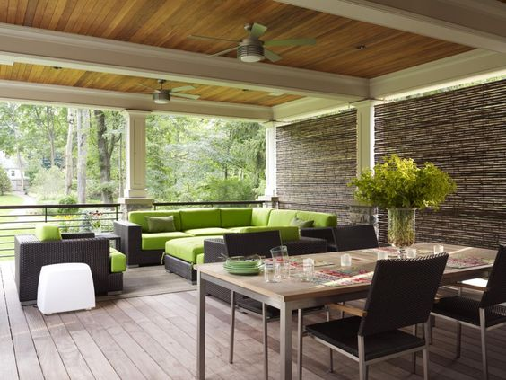 Love!!! Green sectional; woven shades; columns and ceiling beams