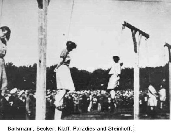 """Stutthof camp guards were publicly hanged, at 5.00 p.m. on July 4th, 1946 at Biskupia Gorka hill near Danzig. Trucks brought the prisoners to the execution ground, hands and legs tied with cords. The trucks were backed under the gallows and the condemned made to stand on the tailboards or on the chairs on which they had sat. When the preparations were complete, each truck was driven forward leaving them suspended. They were not hooded and given only a short drop."""