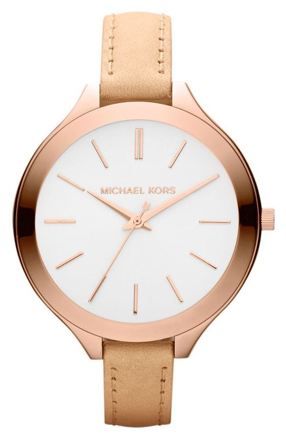 A simple round rose goldtone bezel surrounds the silvery white dial of this timeless Runway watch by Micheal Kors. Keeping time with reliable quartz ...