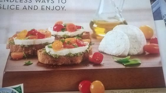Fresh mozzarella bruschetta: Crisp baguette slices topped with pesto, mozzarella slices, and fresh diced tomatoes, sprinkle with fresh torn basil.