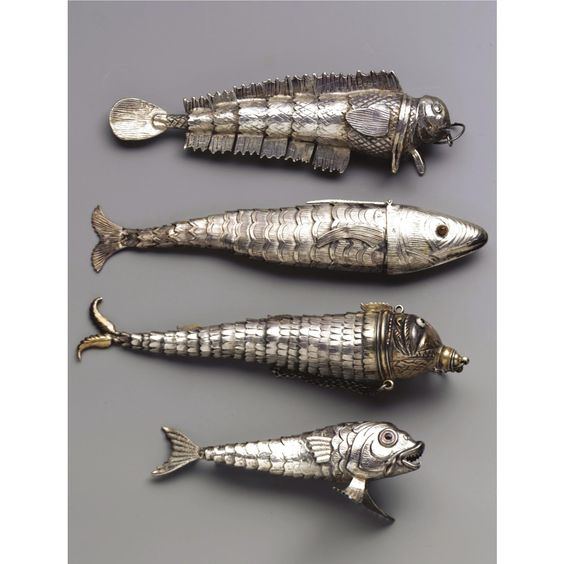 Articulated silver fish with engraved scales