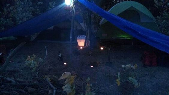 Cheap candles burning under two tarps burned all night long and provided plenty of extra heat coming into our tents on a 35 degree November night ...SDV
