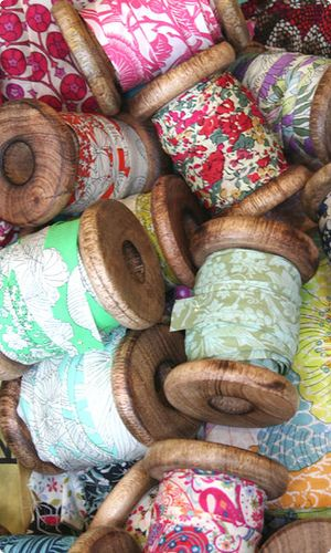 Liberty print bias binding on wooden spools - great way to store bias binding - you can get new wooden spools at craft stores:
