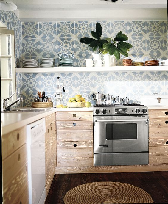 Cover an entire wall with patterned tile to add drama in the kitchen…