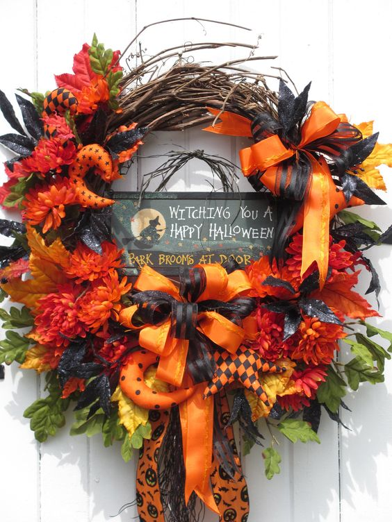 Halloween Wreath, Witch Wreath, Fall Wreath, Door Wreath, Floral Wreath, Hand Made Halloween ornaments, Bright orange and Black color scheme. $134.99, via Etsy.