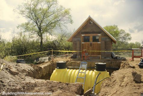 Rainwater Cistern        A buried 1,500 gallon tank is used as a rainwater cistern. The rainwater from the roof is used for flushing the toilet, the cold water for the washing machine, and for some gardening.: