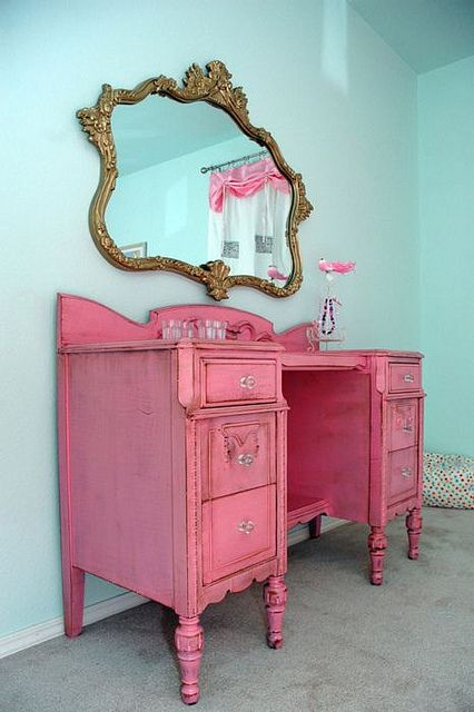 Vanity -- refurbished desk painted and worn down hot pink -- cutte for a girls bedroom maybe? If I had the space in my room I'd be all over it!