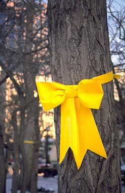"""History of the yellow ribbon.  This site does a great job of explaining the history and has the words to, """"She wore a yellow ribbon""""."""