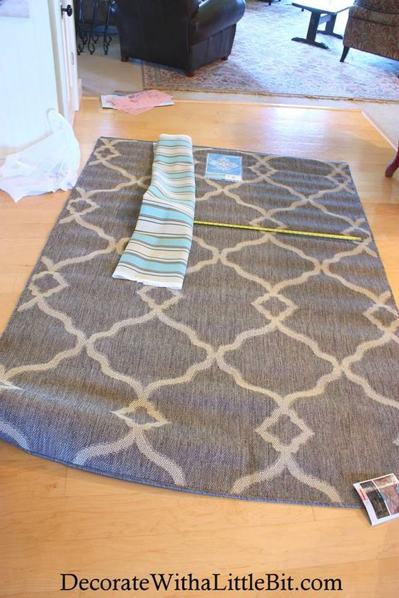 @Brandi Zetrouer  genius....you can cut a rug and sew a fabric along edge to cover where cut!!!!  this is target rug...would work perfectly!
