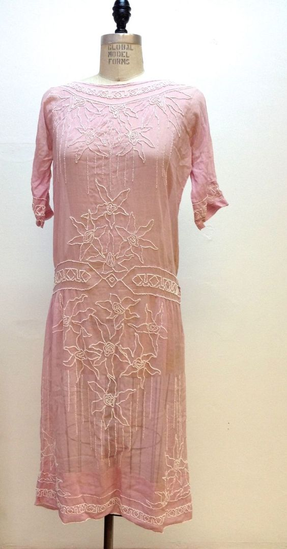 1920,s Antique Art Deco Flapper Pink Cotton Day Dress with White Beaded Flowers. It is made of a slightly sheer pink cotton and white glass beads.