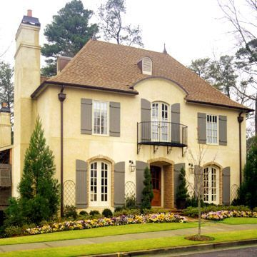 Nice colors of provence yellow stucco with patina green for Houses with stucco and siding