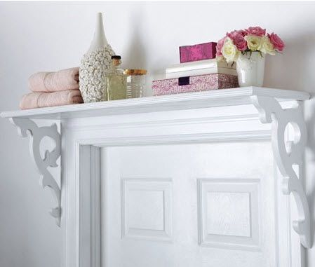 shelf storage above the bathroom door. store extra bath supplies, guest toiletries, towels, maybe flowers :)