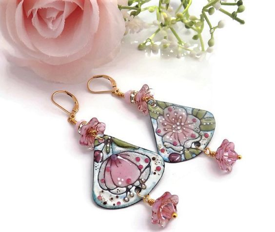 What a cute fun pink flower enamel earrings just in time for the Spring and Summer Season. Are you looking for an unique pair of earrings that is lightweight and easy to wear? Are you looking for that special gift for mom? Look no further. What a beautiful piece of art for your ears! If you love flowers and the color pink then these earrings are a perfect match for you. I can see you wearing these with a cute dress or a pair of jeans.