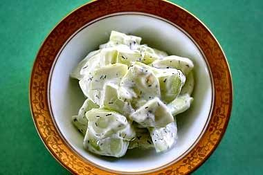 Cucumber yogurt tzatziki, a simple salad of peeled, sliced cucumbers, yogurt, dill, and salt and pepper. To accompany spicy dishes. (use fat-free yogurt)