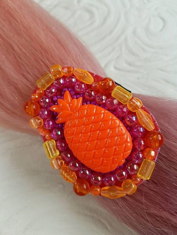 Check out this item in my Etsy shop https://www.etsy.com/nz/listing/514805003/super-orange-pineapple-beaded-hair-tie