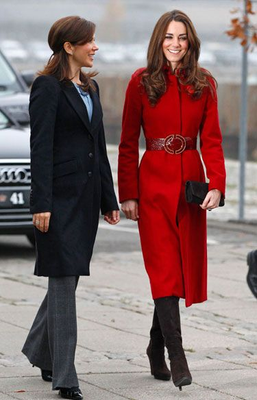 Kate went bold in a red L. K. Bennett coat and boots at a UNICEF Emergency Supply Center in Denmark.