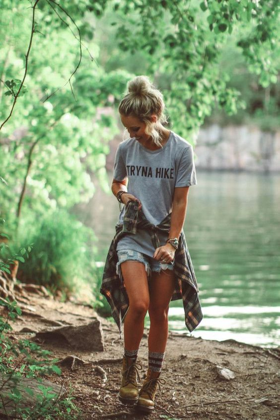 Tryna Hike, always. Women's gray tee made of 90% combed and ring-spun cotton and 10% poly. Go with your normal size for a relaxed fit. Hailey is wearing a Medium. Photos by Bryce Miller of Hailey Mari
