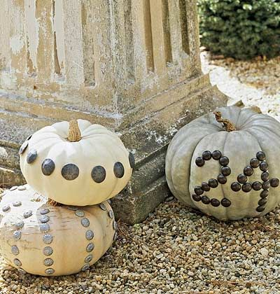 Using upholstery tacks; nailheads or push pins, create a no carve pumpkin. Mimic a design from a pillow or fabric in the room; a monogram or create your street number for outdoor use.
