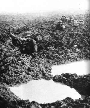 Canadian 4th Division, Passchendaele, 14 November, 1917. Soldiers in mud holes. The wettest summer in memory made Haig's hope of a breakthrough at Passchendaele a nightmare for those who endured the battle.: