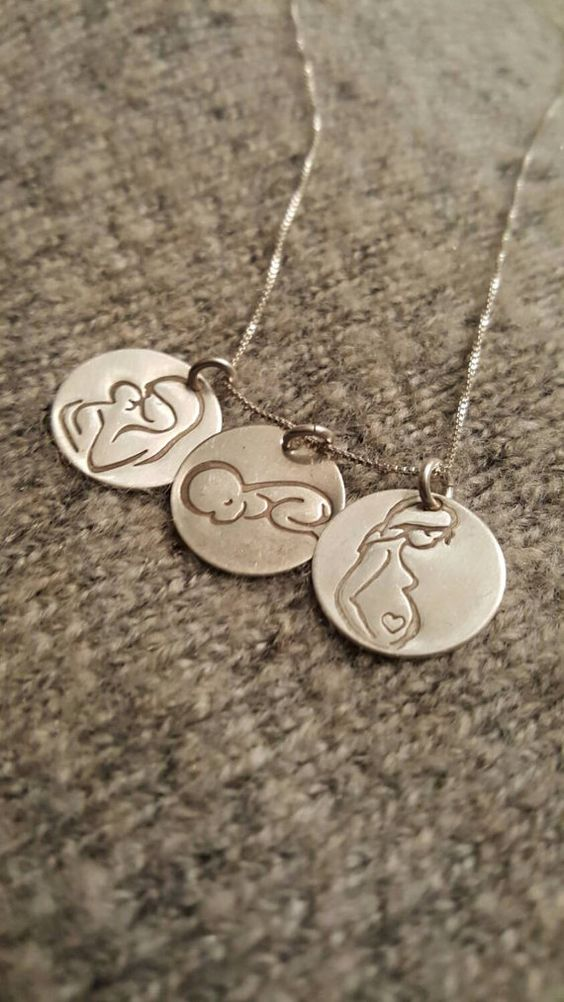Check out this item in my Etsy shop https://www.etsy.com/listing/263267210/mom-pendant-trio-pregnancy-love-story
