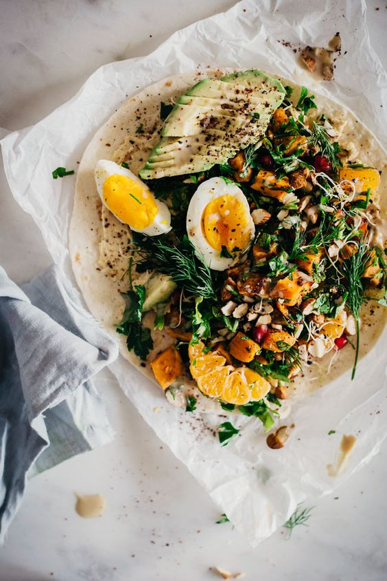 Filling lunch wrap with roasted sweet potato, egg, parsley and hummus | TheAwesomeGreen.com More