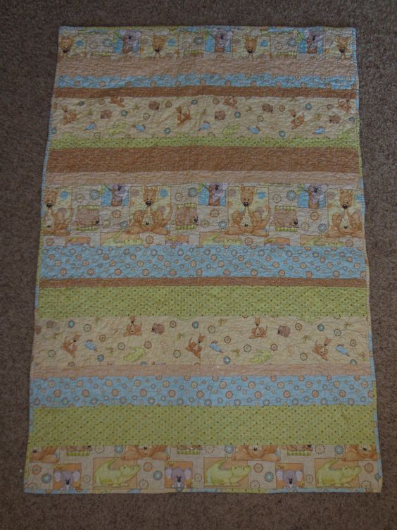 Super Easy Baby Quilt with coordinating fabrics.