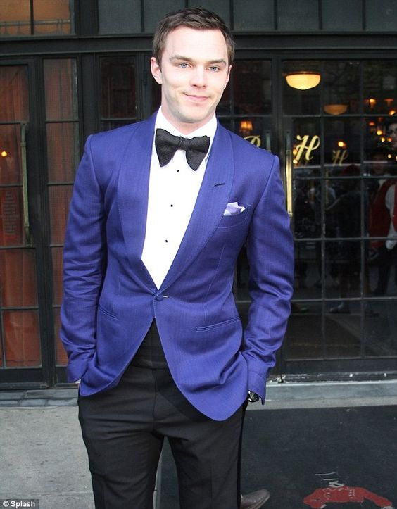 black tuxedo trousers, white shirt, black bow tie and a royal blue