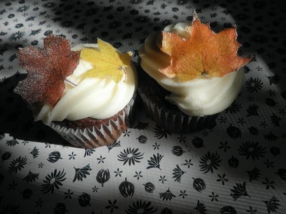 For Stephanie's Wedding: edible fall leaves, $9.95 for a set of 24.  (my idea, have the small cake for cutting and then order frosted but undecorated cupcakes for guests and we could put these on the cupcakes ourselves and save a bit of money?)