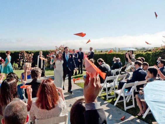 Paper Airplanes! What a great wedding send off.