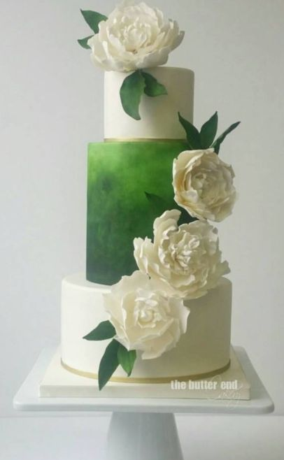 Featured Cake: The Butter End Cakery; Unique green ombre wedding cake topped with white flowers: