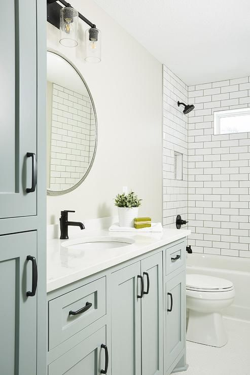 Oil Rubbed Bronze Pulls Accent A Blue Gray Bath Vanity Topped With A White Quartz Countertop Co Bathroom Interior Design Bathroom Interior Bathroom Inspiration