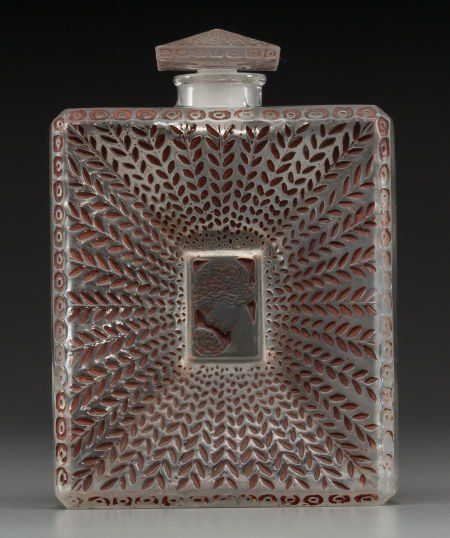 R. Lalique clear glass with sepia enamel La Belle Saison perfume for Houbigant, C. 1925.