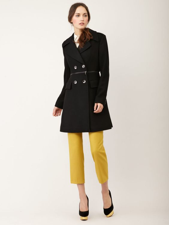 Black coat with mustard yellow pants, love the color combo