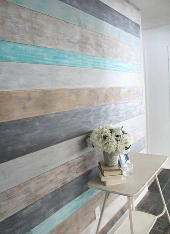 DIY Wood Planked Accent Wall add warmth and texture to your room by adding wood planks to your wall.