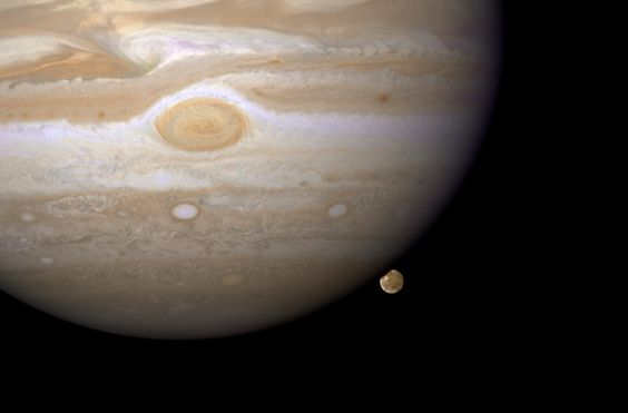 """NASA's Hubble Space Telescope has caught Jupiter's moon Ganymede playing a game of """"peek-a-boo."""" In this crisp Hubble image, Ganymede is shown just before it ducks behind the giant planet. NASA unveils a gorgeous new gallery of celestial images"""
